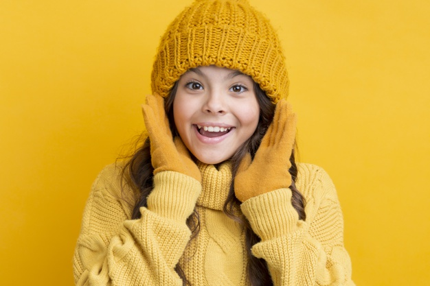 smiley-little-girl-wearing-winter-clothing_23-2148333072